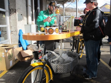 The HUB owner pouring beer out of the coolest bike on earth